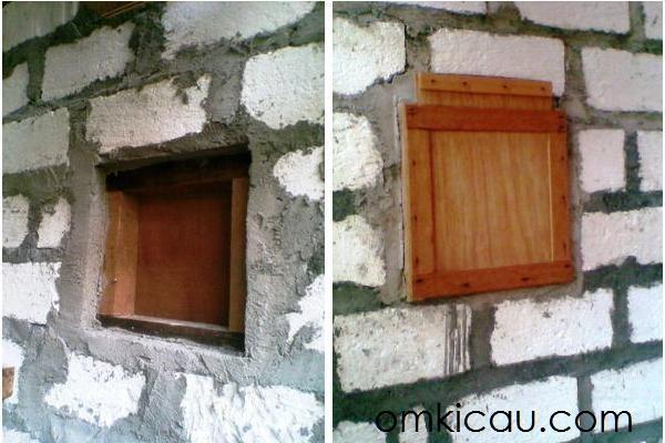 """Sisi satu dan dua jendela antar ruangan. Melalui jendela ini, si jantan diberi akses langsung ke """"kamar"""" betina lain. Jendela dibuat sedemikian rupa sehingga ketika mau memindah jantan, hanya tinggal mengangkat penutup dengan model sliding. Si jantan akan segera pindah kamar begitu jendela ini diangkat."""