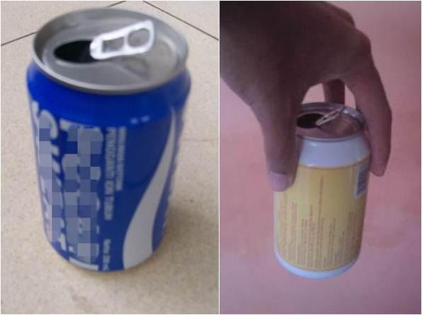 Kaleng bekas minuman dimasukkan batu kecil